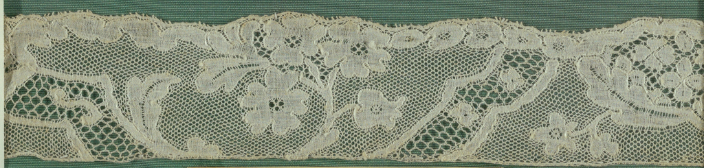 Lace fragment in a Louis XV pattern.