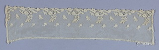 White imitation Alençon with a design of leaves scattered on the field above a border of flower sprays and openwork, which decorate one edge.