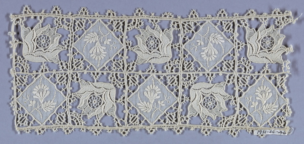 White lace imitating reticella; alternating squares showing 1) flower in needlepoint and 2) plain cloth with embroidered spray. Type of lace made on the Schiffli machine.