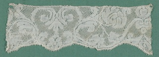 Symmetrical design of scrolling flowering branches and palmettes with scalloped border. Round mesh.