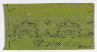 Green cardboard pattern with pricked design for bobbin lace and motif drawn in ink.