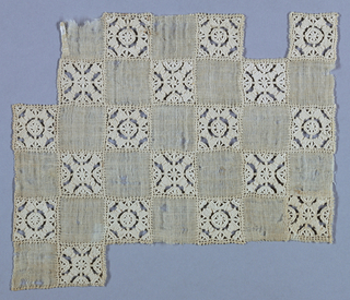 Linen ground with surface divided into squares. Square of needle lace alternates with square of plain linen. Each needle lace square encloses four spool-like motifs grouped around small central square.