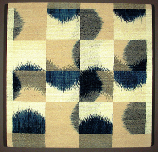 Various blocks of ikat in indigo blue, tan and off-white.