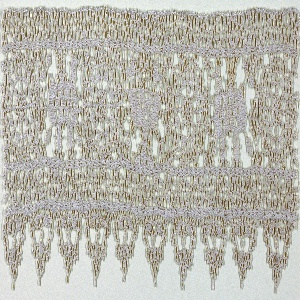 Wide border of squares filled with stylized blossom forms. Edged with pendants on one side.