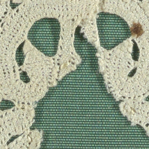 Scallops of bobbin lace forming a border.