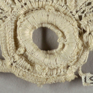 """Flower and leaf ornament in a style known as """"Irish lace."""""""