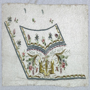Corner of a waistcoat with outer edge and pocket outlined. Below the pocket, two classically-dressed figures with flowering branches are seated with an urn between them.