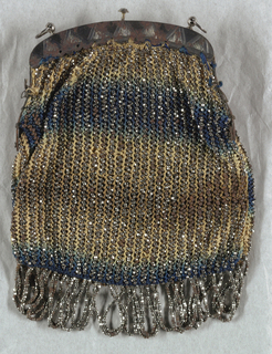 Ladies' purse worked in crochet in blue and tan silk with vertical stripes of steel beads and looped fringe at the bottom. Steel frame for opening.