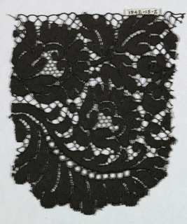 Black Spanish blonde guipure lace; pattern of flowers and leaves and no ground.