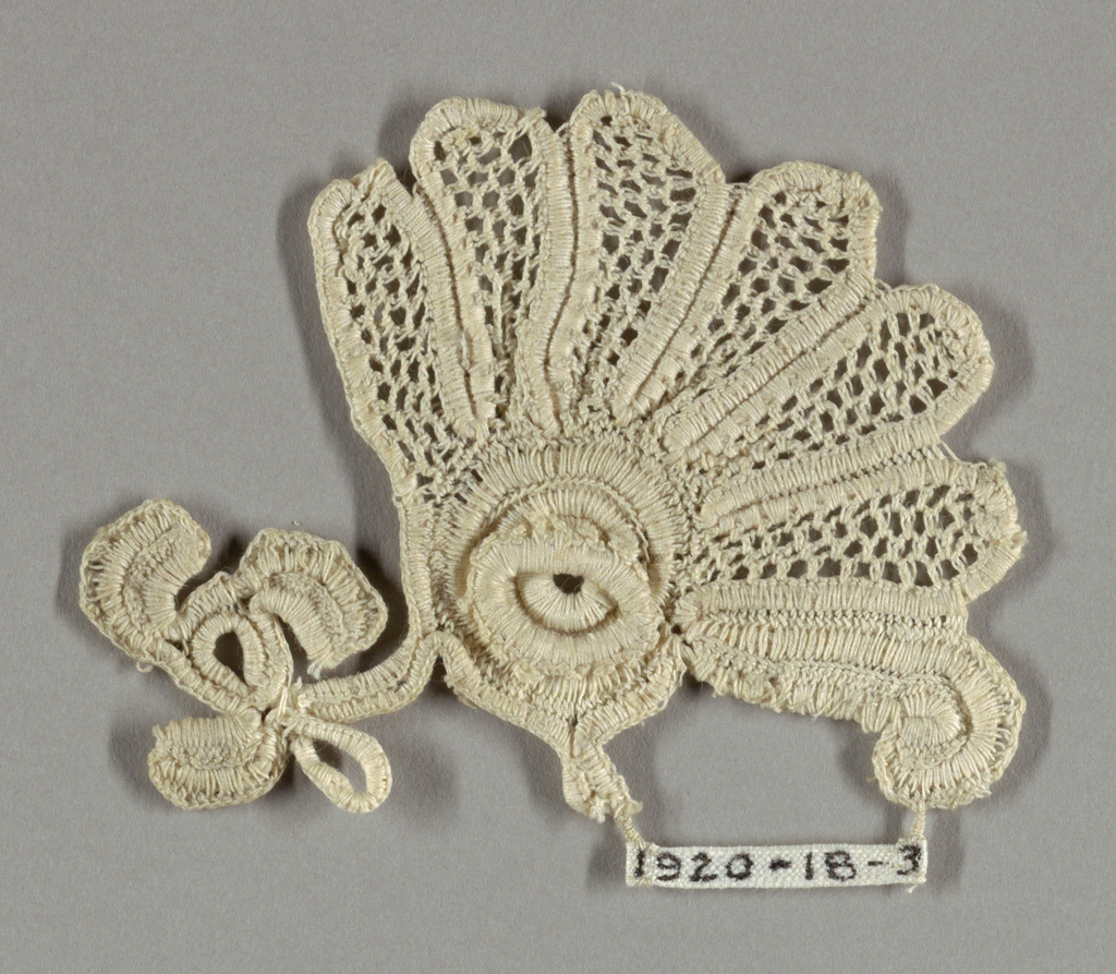 "Flower and leaf ornament in a style known as ""Irish lace."""