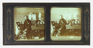 Two glass slides--one lighter--of man seated at a work table with several scientific objects.