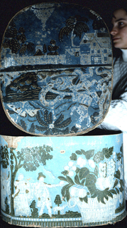 Blue field, printed in white, green and brown. On box, baskets of flowers and fruit, and groups of figures. On cover, portion of picture of Clayton's Ascent and portion of picture of a boat attacked by a sea-serpent.