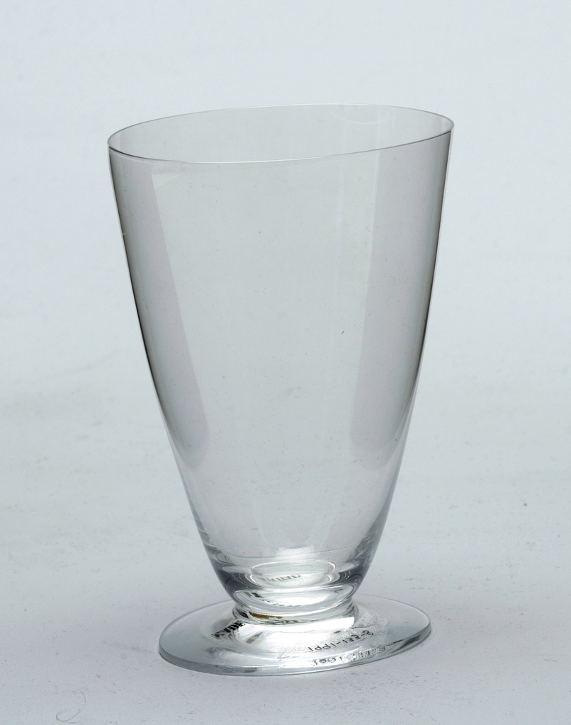 water glass, slightly oval shaped goblet in plan