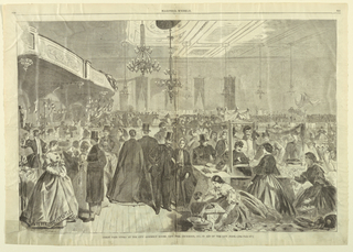 Horizontal view of the interior of a large hall with booths displaying merchandise set up all around it (a numbered booth in lower right foreground) and groups of men and women moving about it.
