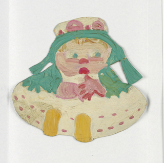 Paper doll of a baby with a green bonnet.