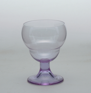 Purple wine glass.  Bulbous goblet in a double bowl shape