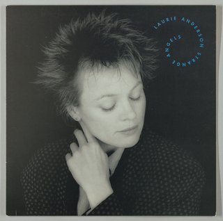 Album recto: Fully occupying the soft black background space is an above-the-waist photograph by Robert Mapplethorpe of Laurie Anderson, her head in a slanted, downward position; her face is in repose, with her eyes closed (or cast downward) and her lips curved slightly upward; her left arm is bent at the elbow and her left hand, fingers partly extended, is touching her head just behind her right ear; her hair is arranged in a spiked, but soft-looking, fashion. She is wearing a ight-on-dark geometically patterned tuxedo or smoking jacket over a wool or linen shirt and has a small post in her visible (right) ear. Her facial expression and pale skin tone produce an otherwordly effect, close in appearance to a death mask. In the upper right, Laurie Anderson Strange Angels is imprinted in small capital letters in electric blue in a spiral format. Verso: On the same black background, In the bottom half, centered, is a frontal above-the waist photograph, also by Mapplethorpe, of Anderson, gazing upward, her lips slightly parted. Her shoulders are hunched forward and her hands, which are not visible, would appear to be in her lap. In the upper right hand corner are a pair of trousered legs and feet in snekers, perhaps Anderson's. To the left, in small capital letters in white, is a vertical list of the album songs, and to the right, production details. List headings are curved, echoing the album title (recto). Inner sleeve: Recto and Verso reproduce the album's song texts. Three vignettes (a seascape, two children in an outdoor setting, a warrior with shield and spear) on one side and pictographs throughout are interspersed with the text.