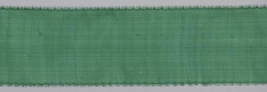 Green ribbon with picot edge.