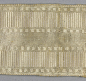 White ribbon with ornamented stripes.