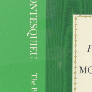 """Cover design fro """"Montesquieu: The Persian Letters"""", by J. Robert Loy. Title and author are printed in black on a rectangle of white paper, bordered with bronze colored repeated foliate motif at center of front cover. Black wood grain printed over green background surrounds rectangle of blank paper with title.  Back cover is green with black and white text. Verso: mirrored scene in woodblock style, in green, featuring a camel rider on a covered pavilion and a man leading amid a forest with animals."""