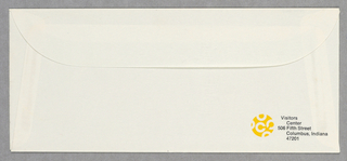 Business envelope in cream with the Visitors Centers logo (C's in a circle) in white on yellow and name and address of the center in black  in lower right corner of the envelope's verso.