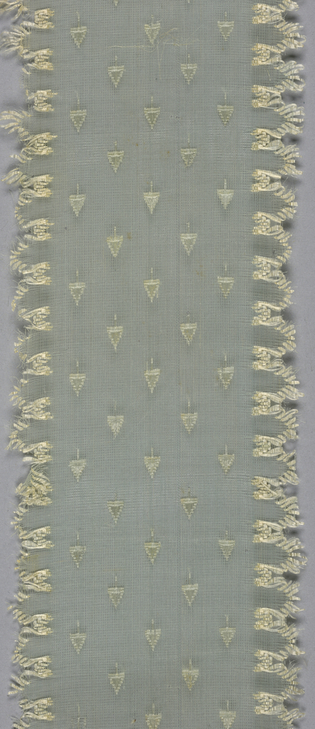 Pale blue gauze cap ribbon with tiny allover tree pattern and white silk scalloped edge.