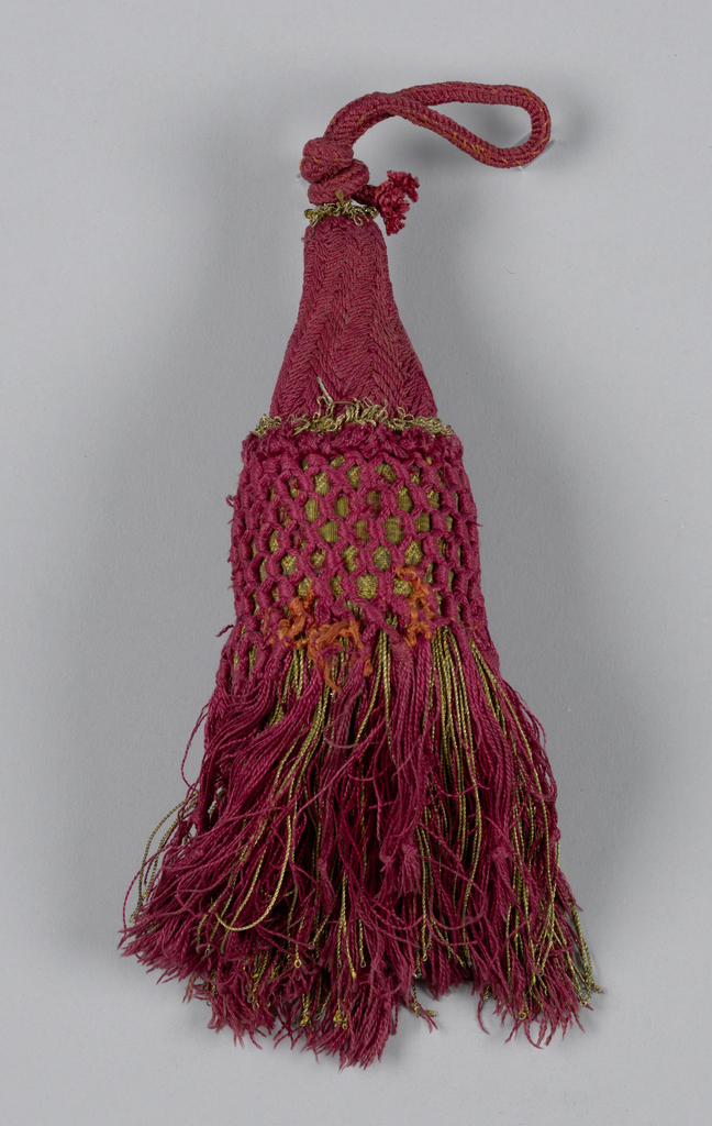 Skirt of red silk and gilt threads hanging from a galloon which is covered with red silk in knotted pattern. Head is covered with red silk in chevron design. Two collars of gold thread and a loop of red silk cord.