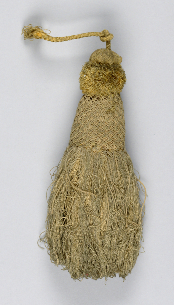 Skirt of gold-colored silk partly covered by a trellis of same colored twisted threads. Collar of cut threads topped by a knob covered with silk threads in twill pattern. Cord of braided silk threads.