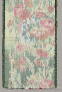 Ribbon with warp-printed design of closely-spaced flowers in rose, blue, brown and green. Green picot edges.