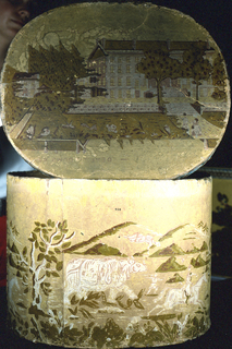 """Box bottom has fanciful scene of rhinoceros with hunters on foot and on horseback, with background of mountains. Lid has view of large building on manicured grounds, with legend of the """"Deaf and Dumb Asylum""""."""