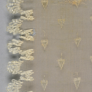 Pale pink gauze ribbon with a tiny, allover tree pattern and a scalloped edge of white silk.