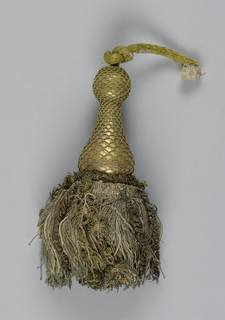 Turned wooden core (vase over flange) covered with strips of metal and collars of metal thread. Skirt of twisted gold threads with twelve ornamental strings of spirals and rosettes. At top, knob covered with gold strips and a loop of gold cord.