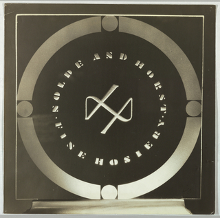 Depicted in white on a black background, the design has the appearance of an illuminated object, perhaps intended for display in the client's offices or retail establishment, and for adaptation to printed matter. Within a circle formed by four thick, equal bands broken by four circles at the top, bottom and sides, the company logo, Nolde and Horst Fine Hosiery, comprised of two semi-circles,  is imprinted in capitals in a stencil-styled type. In the center, an abstract symbol formed by an unbroken, curved line, completes the design.