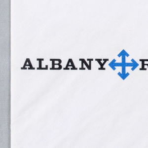 "Envelope for the Albany Report, Inc. Blue insignia at left, centered between ""ALBANY REPORT"" in bold black text, four arrows in a minimalist form of compass rose. Blue printed text vertically at center."