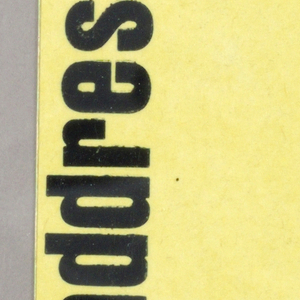 Change of address card for Elaine Lustig, black print on yellow ground. Black printed text vertically at left, new address at lower right.