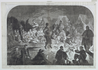Horizontal night scene with a group of soldiers seated and standing around a fire, as one soldier dances in front of the fire and two others play cards, at lower right.