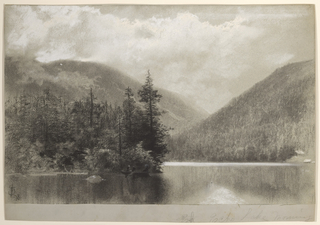 Horizontal view with lake in the foreground, pine trees on the shore on the left, and  mountains covered with growth on the right.