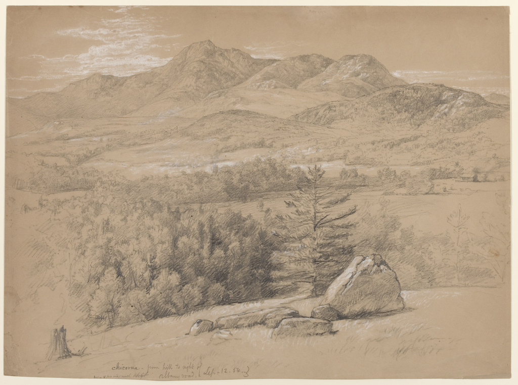 Horizontal view with trees and rocks in foreground leading to a meadow containing a lake, which spreads out before a mountain range in the middle ground, as Mount Chocorua, the highest peak, rises just left of center in the background.