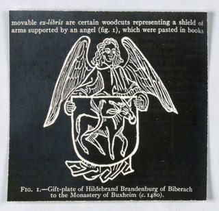 Bookplate: Angel holding crest with image of a donkey on white paper with much black ink. Gift-plate of Hildebrand Brandenburg. Reverse image of 1969-13-4-2.