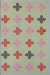 Four petaled flower motif in cut out pink and red tissue paper and black paper arranged in four rows of six.