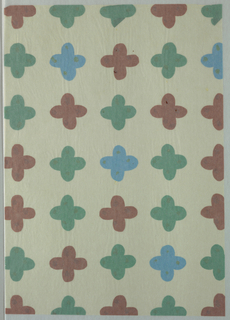 Four petaled flower motif in cut out brown, green and aqua tissue arranged in five rows of seven.