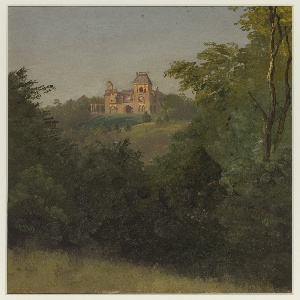 Vertical view of a large, two towered house with balconies and a porch, situated on the overlook of a hill, viewed from a distance with trees and foliage in foreground. Two birch trees at right.