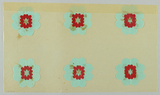 Six flower motifs of blue cut paper with red paper centers.