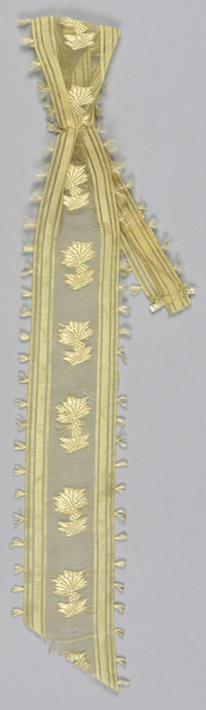 Yellow gauze ribbon with tufts on selvage, stripes and brocaded thistle in self color.