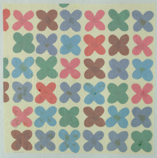 Multicolored four petaled flower motif made from cut tissue papers and arranged in close vertical rows.