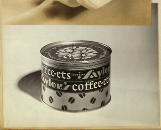 The featured product, a can of Taylor's coffee-ets candy, is photographed in black and white in the center of the page against a shadowed background. The product name is encircles the can on two lines beginning just below the rim of the can, with Taylor's in a variation of stencil-style lettering and coffee-ets in a hand-lettered white type. The lower part of the can is imprinted in an allover pattern of coffee beans. On the rim, in a light color against a dark background, a foliate motif in the center is encircled by product copy imprinted in script.