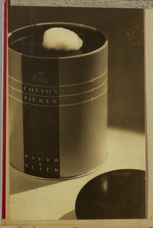 The present object, a dispenser for absorbent cotton, is designed in a round or ovoid shape with a hole centered in the top, underneath the lid, through which the cotton protrudes. In the black and white photograph, which uses highlights and shadows to enhance the object, the dispenser is positioned on the left and the lid in the bottom right corner; both are in partial view. The packaging label, also in partial view, encases the outside of the dispenser and folds over the rim to the inside. A thick black band, punctuating the background from top to bottom, is itself intersected in the top half by three horizontal thin, white lines encircling the entire label. The [hand-lettered up-and-down script style]/ Cotton/ Picker [serif-style capitals] is imprinted above the uppermost band and in between the middle and bottom bands; Bauer/ &/ Black is imprinted just above the bottom rim of the dispenser. To the right of the band, three pairs of miniscule dots appear above and below the lines.