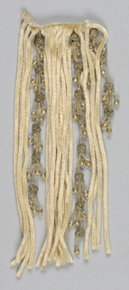 White chenille and gold-colored glass beads with knots of gold and silver metal cord.