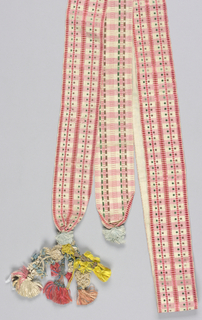 Narrow ribbon in pinks and greenin a repeated, small-scale striped pattern. Elaborate tassels at either end.