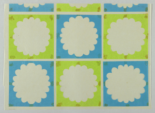 Six full squares of alternating green and blue tissue paper with centers cut out in a flower motif. The inspiration for this design was the sixteen petaled chrysanthemum, the emblem of the mikado, or emperor of Japan. The square at the center of each flower may refer to the tsuba, or ornamental sword guard.